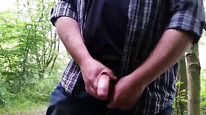 Beau plays with man rod in the forest