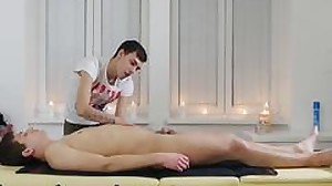 Ryan lies down on the massage table for a full..