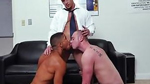 Two studs are licking a huge cock of a boss and..